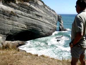 NEW ZEALAND Cape Farewell view rock arch man